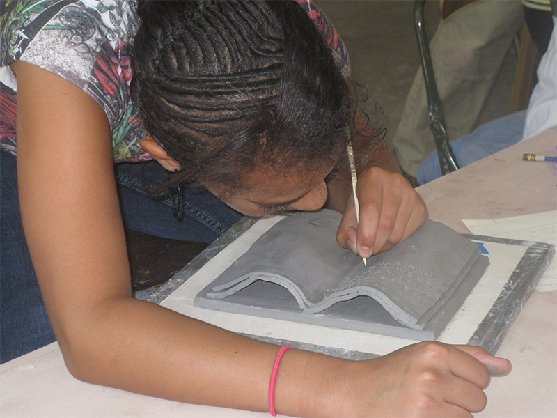 Yound student working on a ceramics project